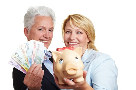 win money: Happy elderly women holding piggy bank and Euro money bills