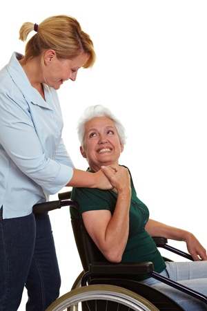 mobility nursing: Extended care nurse helping disabled senior woman in wheelchair Stock Photo