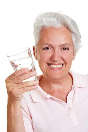 Happy senior Woman mit einem Glas Wasser Standard-Bild - 10585663