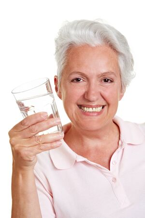deficiency: Happy senior woman with a glass of fresh water Stock Photo