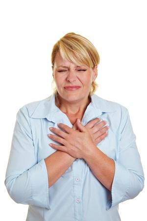 attacco cardiaco: Donna d'affari che hanno attacchi di cuore tenendo petto