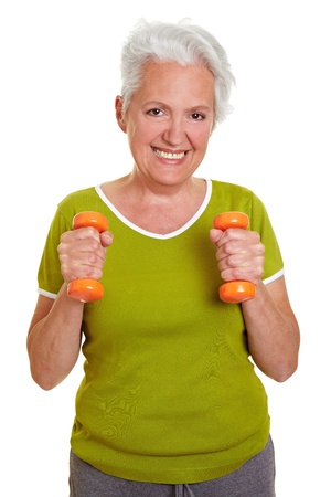Happy senior woman exercising with two dumbbells photo