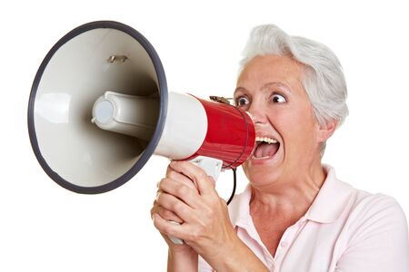 protest: Senior woman using big megaphone