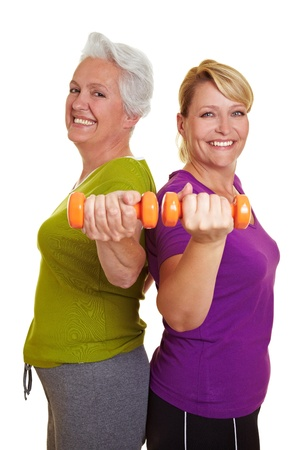 senior citizens: Happy senior women making fitness training with dumbbells