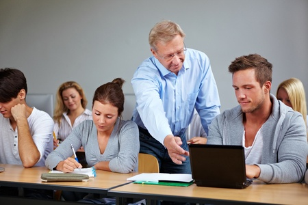 computer class: Teacher in university talking to his students