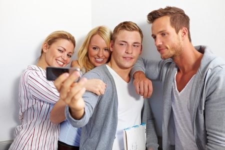 Group photo of smiling students with cell phone Stock Photo - 10681801