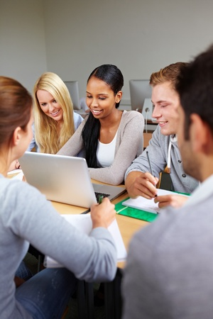 Happy study group with students in university photo