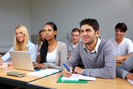 university classroom: Busy students learning in a university class Stock Photo