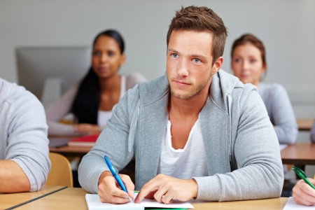 training course: Young student taking notes in university class Stock Photo