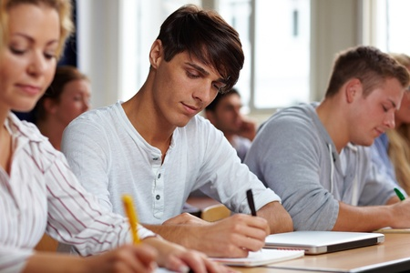 Students taking a test in university class photo