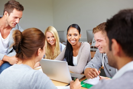 computer lessons: Happy female african student with their peers in college Stock Photo