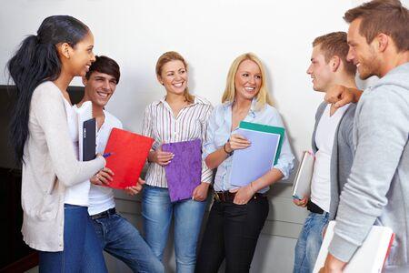 Happy students having a break in university hall Stock Photo - 10681783