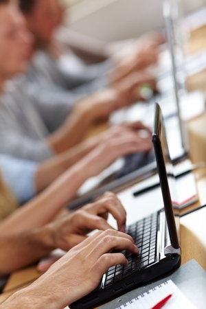 dual: Many hands typing on laptops or netbooks