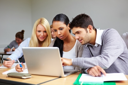 tutorial: Students in university class learning at laptop Stock Photo