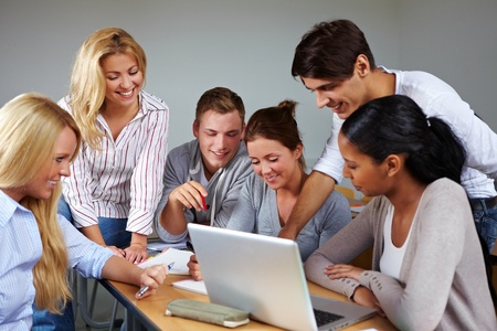 training course: Studients doing group work in university class Stock Photo