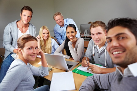Happy students with teacher in university class Stock Photo - 10681780