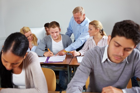 Students learning together in class at university photo