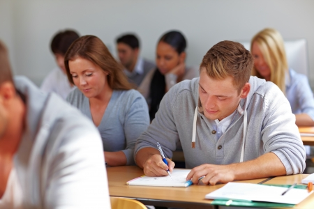Many students learning in class at university