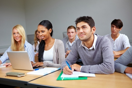classroom training: Many students listening in a university class