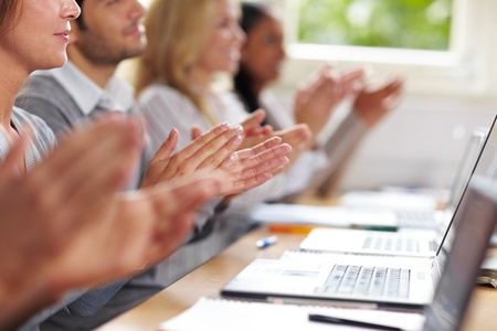 classroom training: Students clapping hands for applause after university lecture Stock Photo