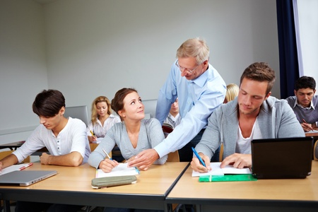 college classroom: Assistance of students at university with a teacher