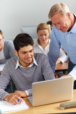 university classroom: Assistance for student from teacher in university