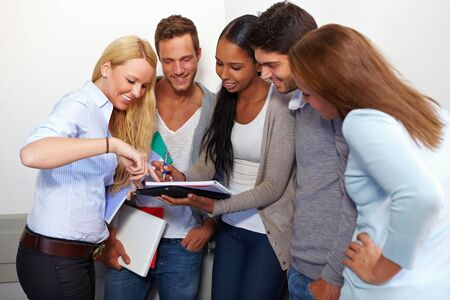 assignments: Students discussing assignments for class in university Stock Photo