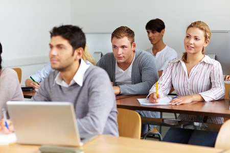 Many students learning in a university class photo