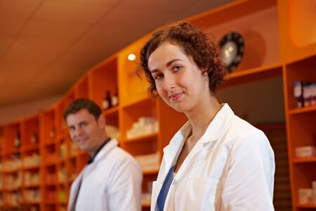 Portrait of male and female pharmacists in a pharmacy photo