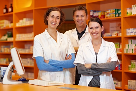 Happy pharmacy team with pharmacist and pharmacy technicians Stock Photo - 10971296