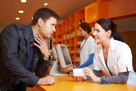recommendation: Customer with flu in pharmacy talking to a pharmacist Stock Photo