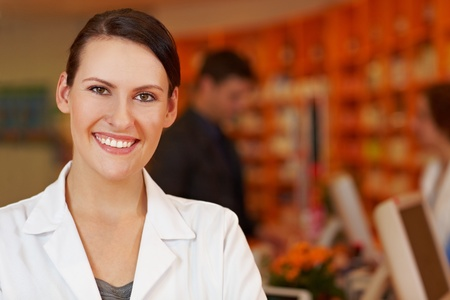 Portrait of a happy and content pharmacist in pharmacy photo