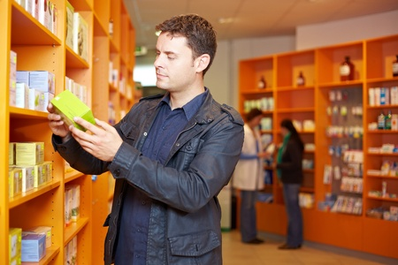 Man shopping for medication in a pharmacy photo
