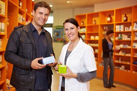 Happy customer with a pharmacist in a pharmacy Stock Photo - 10971319