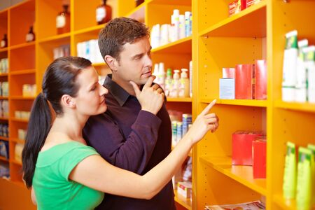 Couple shopping for medical products in a pharmacy Stock Photo - 10971295