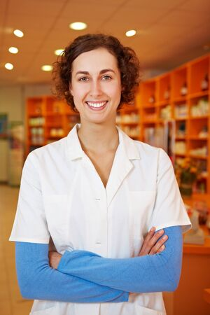 Confident female pharmacist with arms crossed in her pharmacy Stock Photo - 10971334