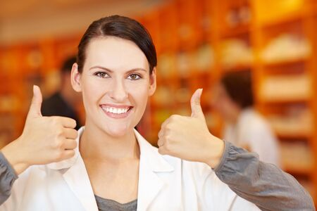 recommendation: Pharmacist holding both her thumbs up in a pharmacy