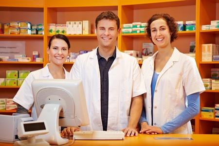 pharmacy technician: Competent pharmacy team with pharmacist and pharmacy technicians Stock Photo
