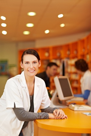 Portrait of smiling pharmacist in a pharmacy photo
