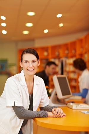 pharmacy technician: Portrait of smiling pharmacist in a pharmacy Stock Photo