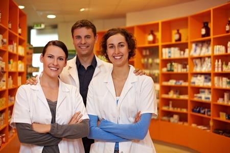 Confident pharmacy team with pharmacist and pharmacy technicians
