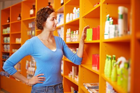 Young woman going shopping for medication in a drugstore photo