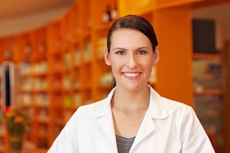 Portrait of a smiling pharmacy technician in pharmacy