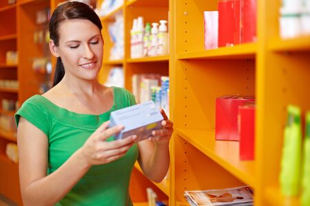 consumers: Happy woman shopping for products in a drugstore Stock Photo