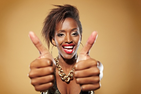 Happy african woman holding both her thumbs up Stock Photo - 11396146