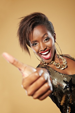 Happy young african woman holding her thumbs up Stock Photo - 11396150