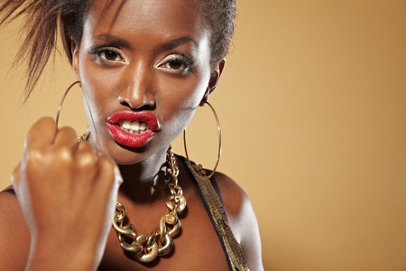 Angry young african woman clenching her fist photo