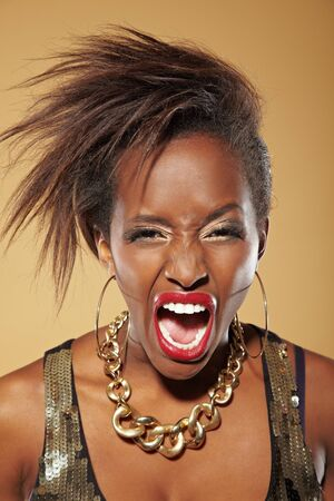 rant: Angry frustrated young african woman screaming loudly Stock Photo
