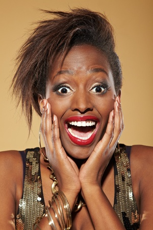 women face stare: Young happy stylish african woman looking surprised
