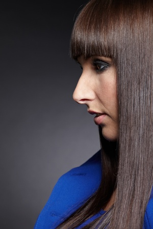 long nose: Profile view of a young woman with pageboy haircut Stock Photo